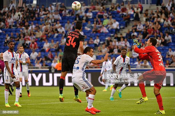 Benfica's Portuguese defender Andre Almeida heads the ball and scores during the friendly football match between Olympique Lyonnais and SL Benfica at...