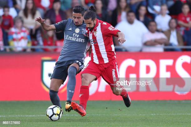 Benfica's Portuguese defender Andre Almeida with Ave´s player Nelson Lanho during the Premier League 2017/18 match between CD Aves and SL Benfica at...
