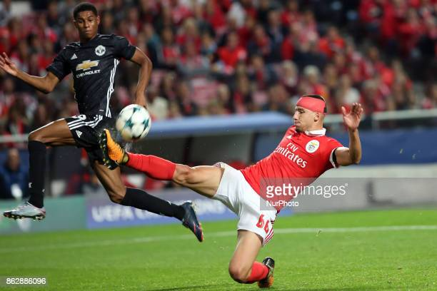 Benfica's Portuguese defender Ruben Dias fights for the ball withManchester United's forward Marcus Rashford during the UEFA Champions League...