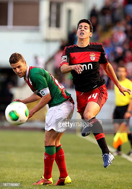 Benfica's Portuguese midfielder Andre Almeida vies with Maritimo's defender Briguel Sousa during the Portuguese League football match Maritimo vs SL...