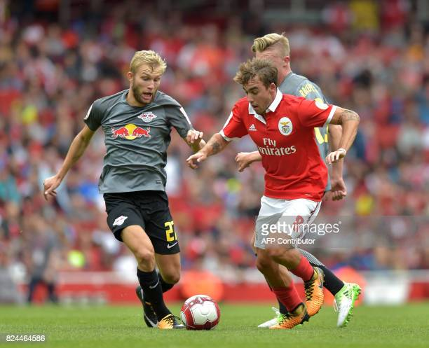 Benfica's Portuguese midfielder Andre Horta vies with Leipzig's Austrian midfielder Konrad Laimer during the preseason friendly football match...