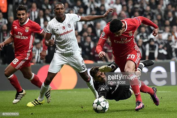 Benfica's Portuguese midfielder Gocalo Guedes scores a goal next to Besiktas' Marcello during the UEFA Champions League Group B football match...