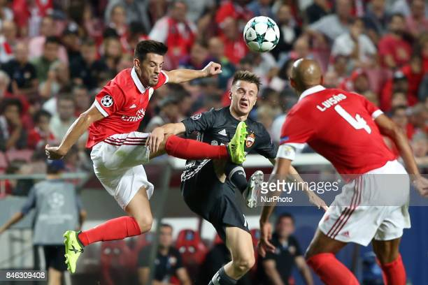Benfica's Portuguese midfielder Pizzi fights for the ball with CSKA's midfielder Aleksandr Golovin during UEFA Champions League football match SL...