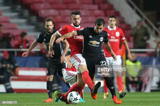 Benfica's Portuguese midfielder Pizzi fights for the ball with Manchester United's Armenian midfielder Henrikh Mkhitaryan during the UEFA Champions...