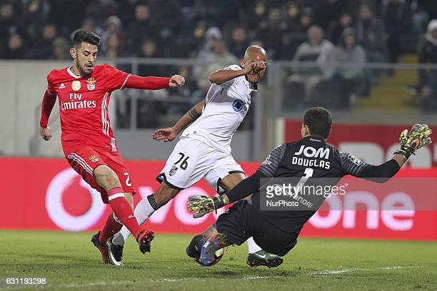 Benfica's Portuguese midfielder Pizzi with Vitoria SC's Portuguese defender Bruno Gaspar with Vitoria SC's Brazilian goalkeeper Douglas during the...