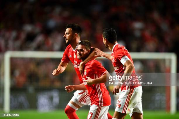 Benfica's Serbian forward Andrija Zivkovic celebrates a goal with teammates Benfica's defender Andre Almeida and Benfica's Greek midfielder Andreas...