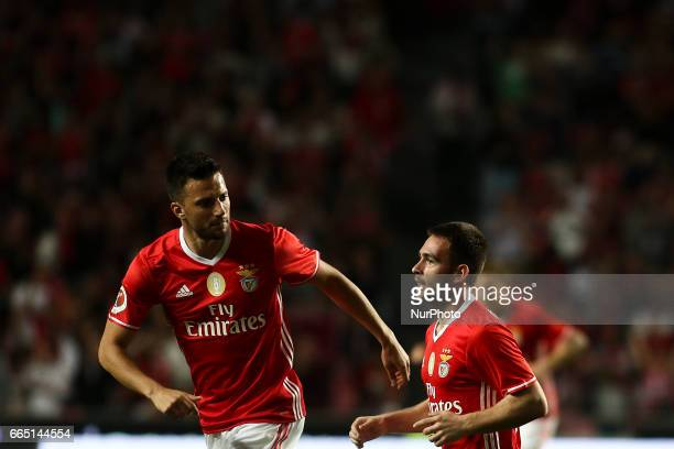 Benfica's Serbian forward Andrija Zivkovic celebrates with Benfica's Greek midfielder Andreas Samaris after scoring during the Portuguese Cup...