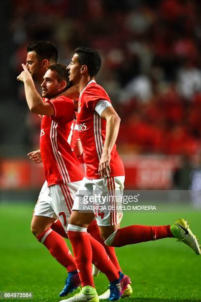 Benfica's Serbian forward Andrija Zivkovic celebrates with his teammates Benfica's defender Andre Almeida and Benfica's Greek midfielder Andreas...