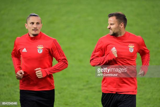 Benfica's Serbian midfielder Ljubomir Fejsa and teammate Swiss forward Haris Seferovic warms up during a training on the eve of the UEFA Champions...