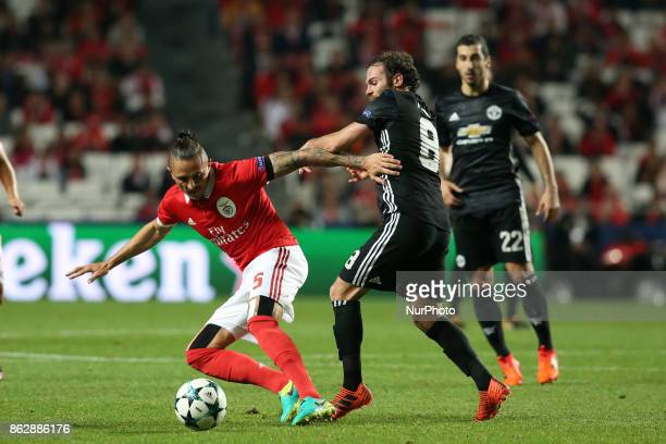 Benfica's Serbian midfielder Ljubomir Fejsa fights for the ball with Manchester United's Spanish midfielder Juan Mata during the UEFA Champions...