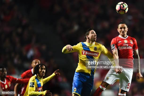 Benfica's Serbian midfielder Ljubomir Fejsa heads the ball with Arouca's forward Tomane during the Portuguese league football match SL Benfica vs FC...