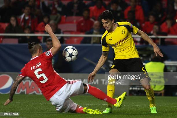 Benfica's Serbian midfielder Ljubomir Fejsa makes a penalty next to Dortmund's defender Bartra during the Champions League football match between SL...