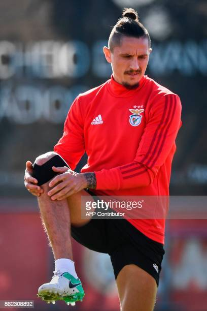 Benfica's Serbian midfielder Ljubomir Fejsa stretches during a training session at the club's training ground in Seixal in the outskirts of Lisbon on...