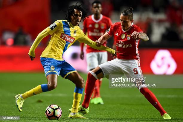 Benfica's Serbian midfielder Ljubomir Fejsa vies with Arouca's Cape Verdean Kuca Miranda during the Portuguese league football match SL Benfica vs FC...