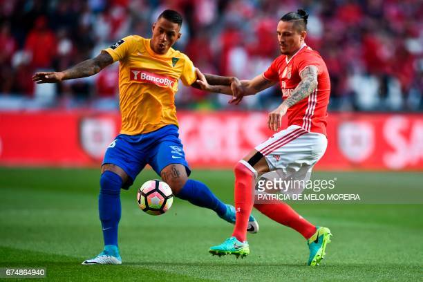 Benfica's Serbian midfielder Ljubomir Fejsa vies with Estoril's Brazilian midfielder Carlinhos de Jesus during the Portuguese league football match...