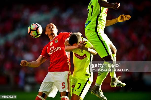 Benfica's Serbian midfielder Ljubomir Fejsa vies with Maritimo's midfielder Alexandre Soares during the Portuguese League football match SL Benfica...