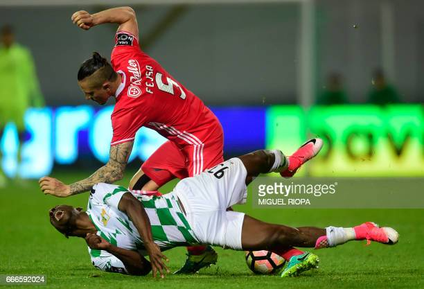 Benfica's Serbian midfielder Ljubomir Fejsa vies with Moreirense's French forward Ousmane Drame during the Portuguese league football match...