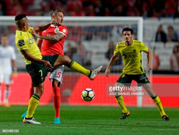 Benfica's Serbian midfielder Ljubomir Fejsa vies with Pacos Ferreira's Brazilian forward Welthon Sampaio and forward Bruno Moreira during the...