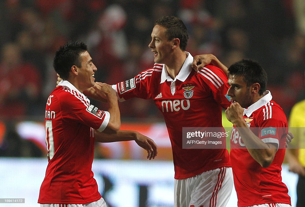 SL Benfica's Serbian Nemanja Matic (C) celebrates with teammates Benfica's Argtentinian forward Eduardo Salvio (R) and Benfica's Argentinian forward Nicolas Gaitan (L) after scoring during the Portuguese league football match SL Benfica vs FC Porto at Luz Stadium in Lisbon on January 13, 2013.