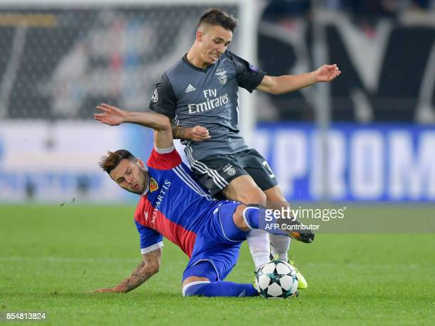 Benfica's Spanish defender Alejandro Grimaldo and Basel's Swiss midfielder Renato Steffen fight for the ball during the UEFA Champions League Group A...