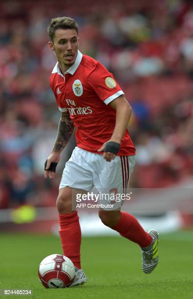 Benfica's Spanish defender Alex Grimaldo runs with the ball during the preseason friendly football match between RB Leipzig and Benfica at The...
