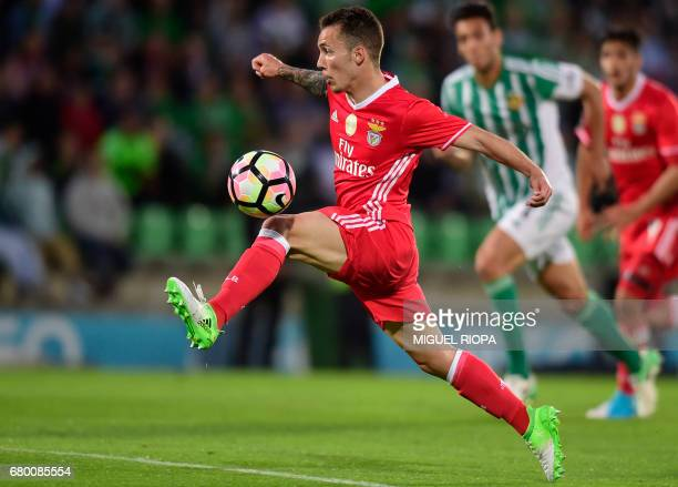 Benfica's Spanish defender Alex Grimaldo tries to control the ball during the Portuguese league football match Rio Ave FC vs SL Benfica at the Rio...