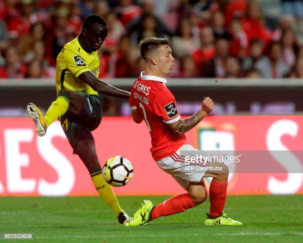 Benfica's Spanish defender Alex Grimaldo vies with Pacos Ferreira's Australian forward Awer Mabil during the Portuguese league football match SL...