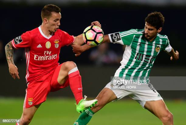 Benfica's Spanish defender Alex Grimaldo vies with Rio Ave's forward Gil Dias during the Portuguese league football match Rio Ave FC vs SL Benfica at...