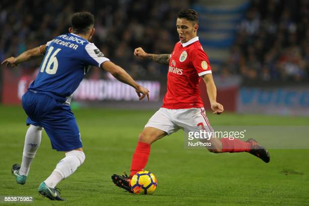 Benfica's Spanish defender Alex Grimaldo with Porto's Mexican midfielder Hector Herrera during the Premier League 2016/17 match between FC Porto and...