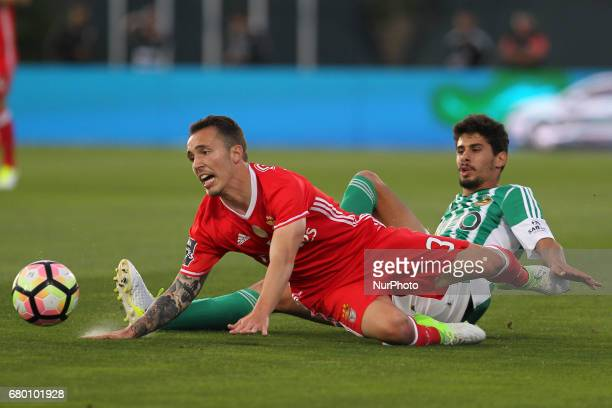 Benfica's Spanish defender Alex Grimaldo with Rio Ave's Portuguese forward Gil Dias during the Premier League 2016/17 match between Rio Ave and SL...