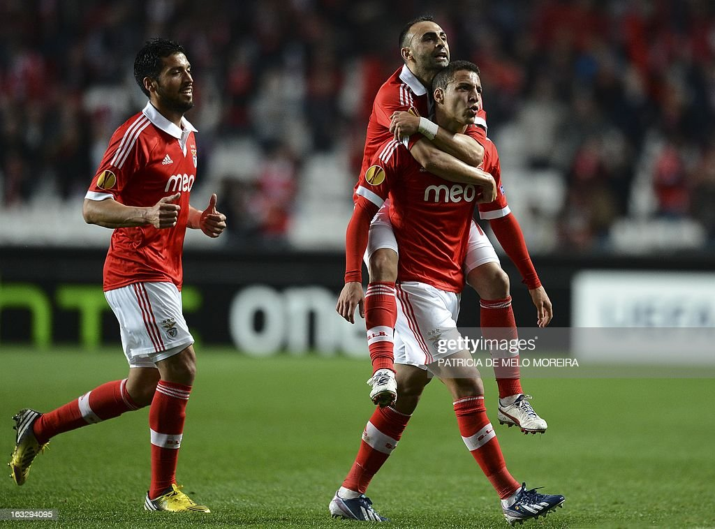 Benfica's Spanish forward Rodrigo (R) celebrates with his teammates after scoring during the UEFA Europa League round of 16 first leg football match SL Benfica vs FC Girondins de Bordeaux at the Luz stadium in Lisbon on March 7, 2013.