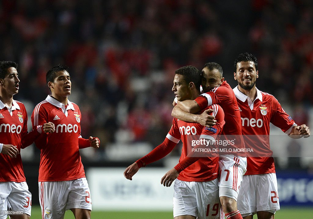 Benfica's Spanish forward Rodrigo (C) celebrates with his teammates after scoring during the UEFA Europa League round of 16 first leg football match SL Benfica vs FC Girondins de Bordeaux at the Luz stadium in Lisbon on March 7, 2013.