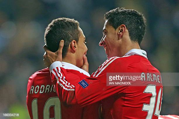 Benfica's Spanish striker Rodrigo celebrates with Portuguese defender Andre Almeida after Benfica equalize during the UEFA Europa League quarterfinal...