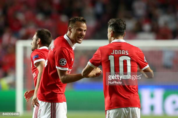 Benfica's Suisse forward Haris Seferovic celebrates with Benfica's Brazilian forward Jonas after scoring a goal during UEFA Champions League football...