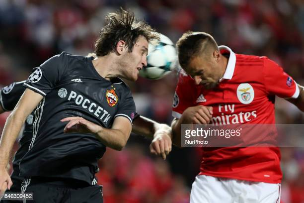 Benfica's Suisse forward Haris Seferovic heads the ball with CSKA's defender Mario Fernandes during UEFA Champions League football match SL Benfica...