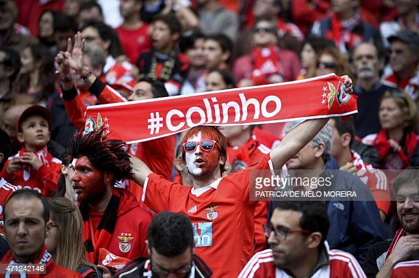 A Benfica's supporter brandishes a scarve moments before the Portuguese league football match SL Benfica vs FC Porto at Luz stadium in Lisbon on...