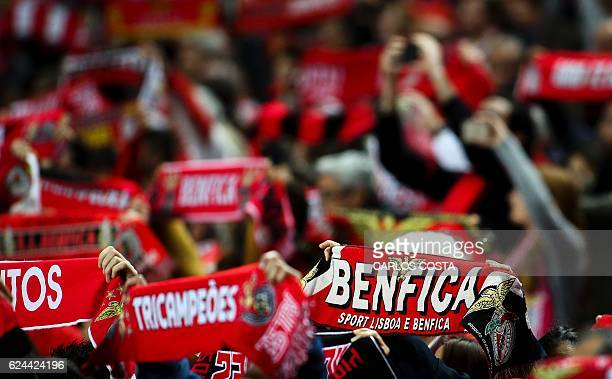 Benfica's supporters brandish their scarves before the Portuguese Cup football match SL Benfica vs CS Maritimo at the Luz stadium in Lisbon on...