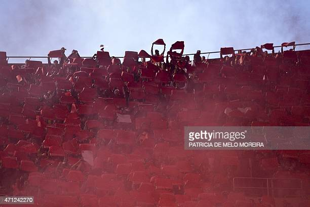 Benfica's supporters hold scarfs and posters moments before the Portuguese league football match SL Benfica vs FC Porto at Luz stadium in Lisbon on...