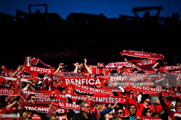 TOPSHOT Benfica's supporters hold scarfs moments before the Portuguese league football match SL Benfica vs Estoril at the Luz stadium in Lisbon on...