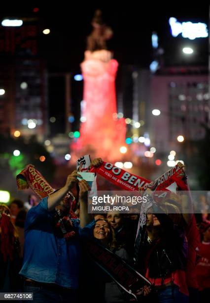 Benfica's supporters take pictures as they gather at Marques de Pombal square in downtown Lisbon on May 13 2017 to celebrate their team's victory in...