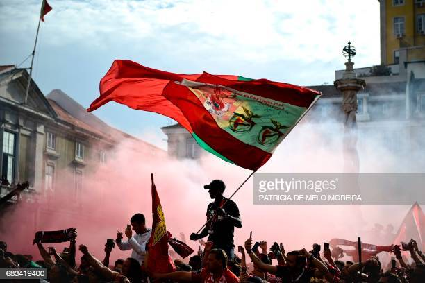 TOPSHOT Benfica's supporters wave flags as they wait for their team to arrive at Lisbon's City Hall to celebrate their team's victory in the 20162017...