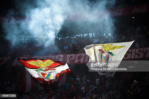 Benfica's supporters wave flags during the Portuguese Liga football match Benfica vs Moreirense at Luz stadium in Lisbon on September 21 2014 AFP...