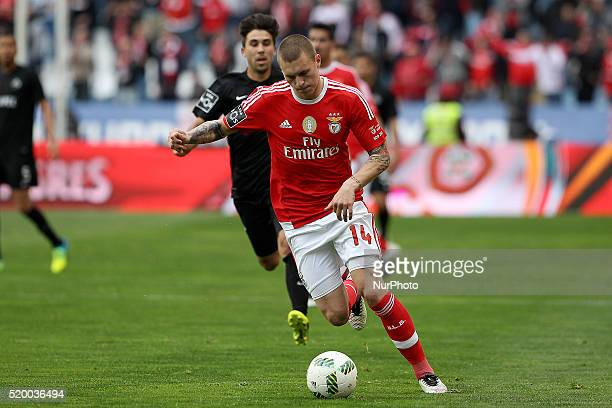 Benfica's Swedish defender Victor Lindelöf in action with Academica's Portuguese midfielder Pedro Nuno during the Premier League match between...