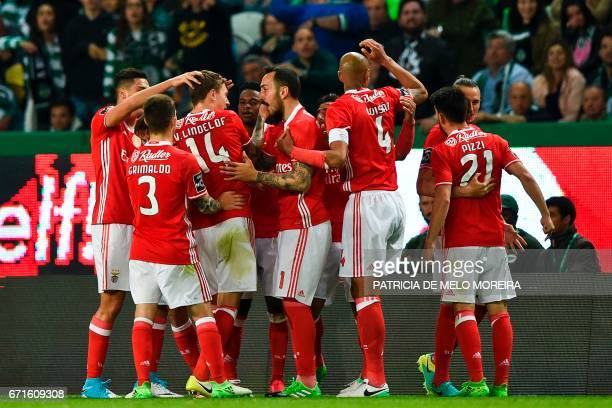 Benfica's Swedish defender Victor Lindelof celebrates a goal with teammates during the Portuguese league football match Sporting CP vs SL Benfica at...
