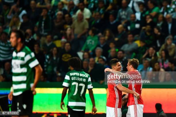 Benfica's Swedish defender Victor Lindelof celebrates a goal with Benfica's Mexican forward Raul Jimenez during the Portuguese league football match...