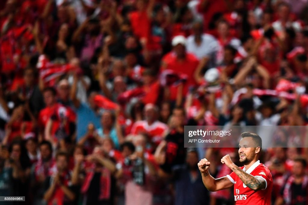 Benfica's Swiss forward Haris Seferovic celebrates after scoring during the Portuguese League football match SL Benfica vs Os Belenenses at Luz stadium on August 19, 2017. /