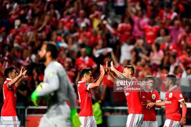 Benfica's Swiss forward Haris Seferovic celebrates with his teammate Benfica's Brazilian forward Jonas Oliveira during the Portuguese League football...