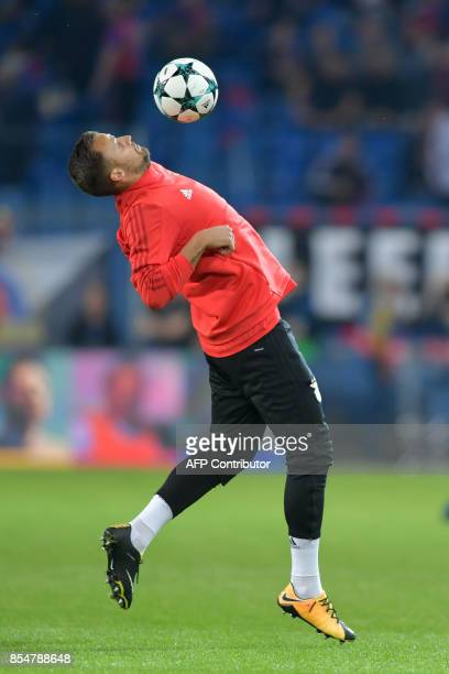 Benfica's Swiss forward Haris Seferovic controls the ball as he warms up ahead of the UEFA Champions League Group A football match between FC Basel...