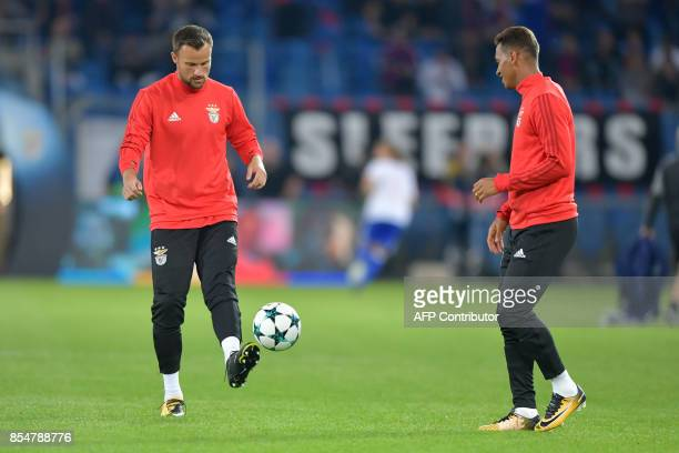 Benfica's Swiss forward Haris Seferovic controls the ball as he warms up with a teammate ahead of the UEFA Champions League Group A football match...