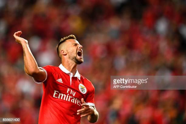 Benfica's Swiss forward Haris Seferovic reacts after missing an opportunity to score during the Portuguese League football match SL Benfica vs Os...